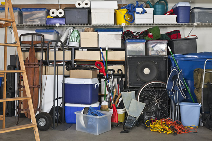 Garage bursting at the seams with piled up clutter
