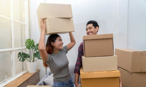 Young couple packing boxes to put into self storage