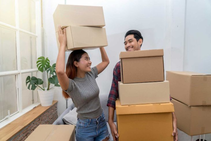 Couple with boxes to fill 10x20 storage unit