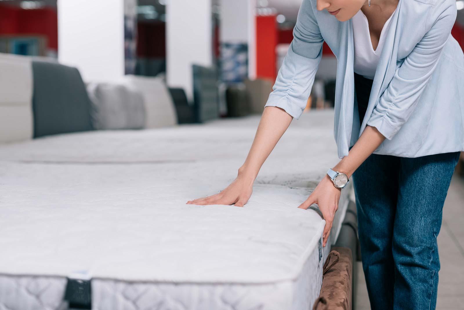 Woman prepares a mattress for self storage.