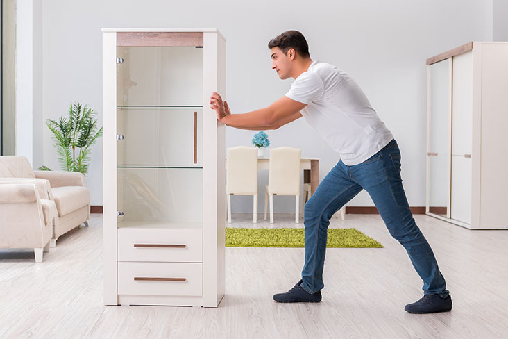 Man prepares to move a dresser to a self storage unit