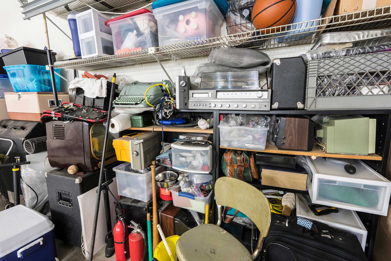 Boxes and sports equipment in a large storage unit.