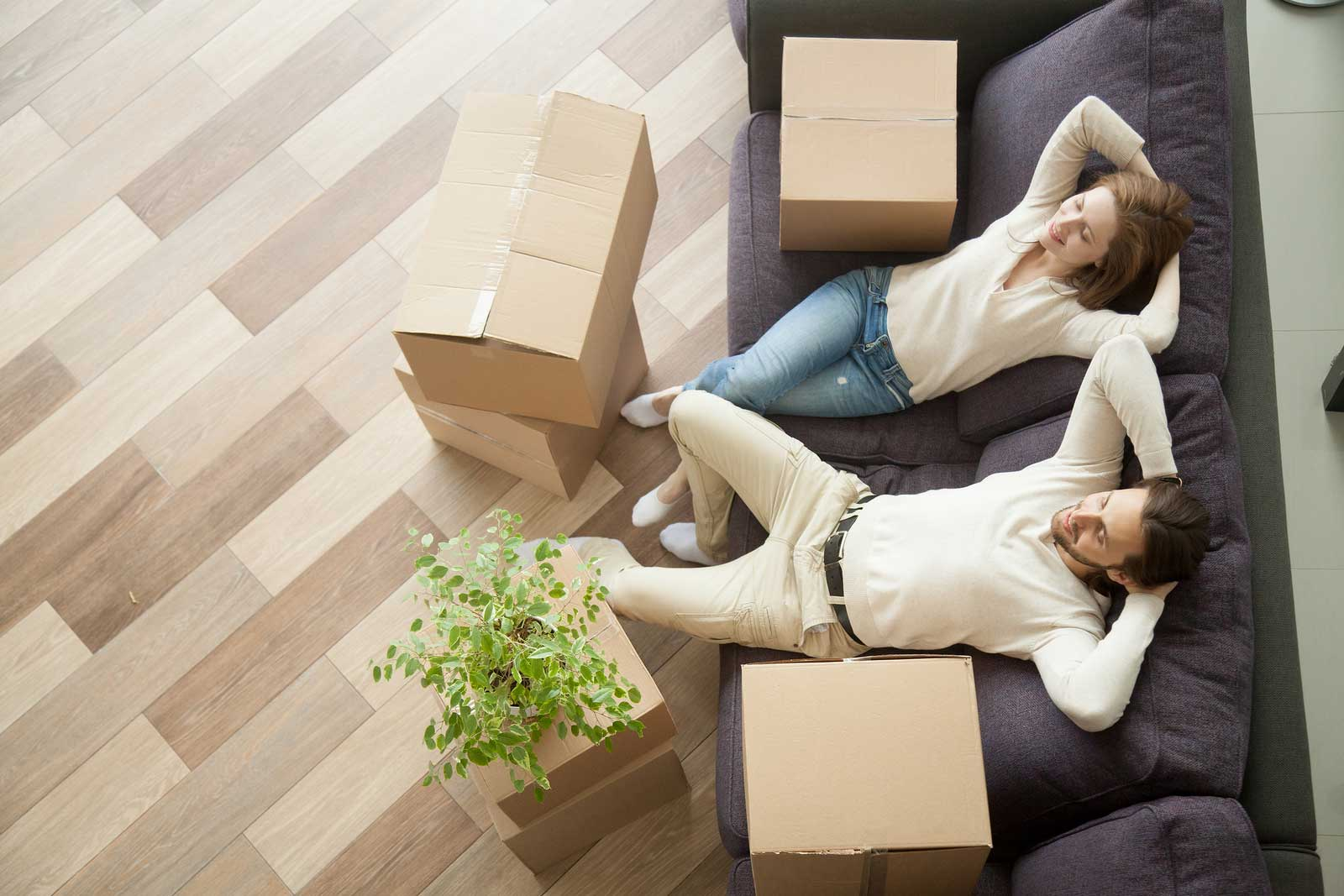 Couple lounges after utilizing self storage for apartments