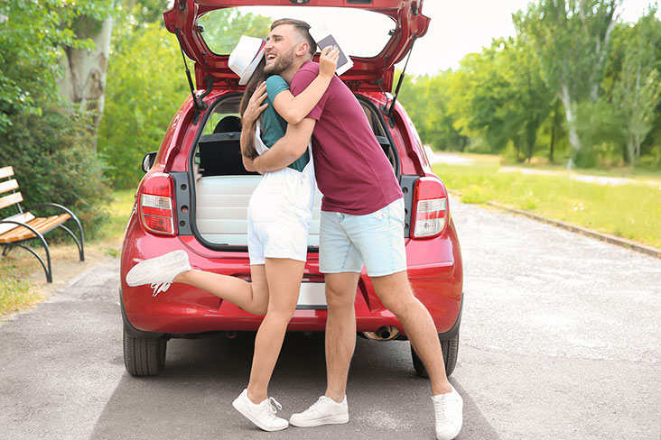 College friends get ready to head back to school with a packed car.