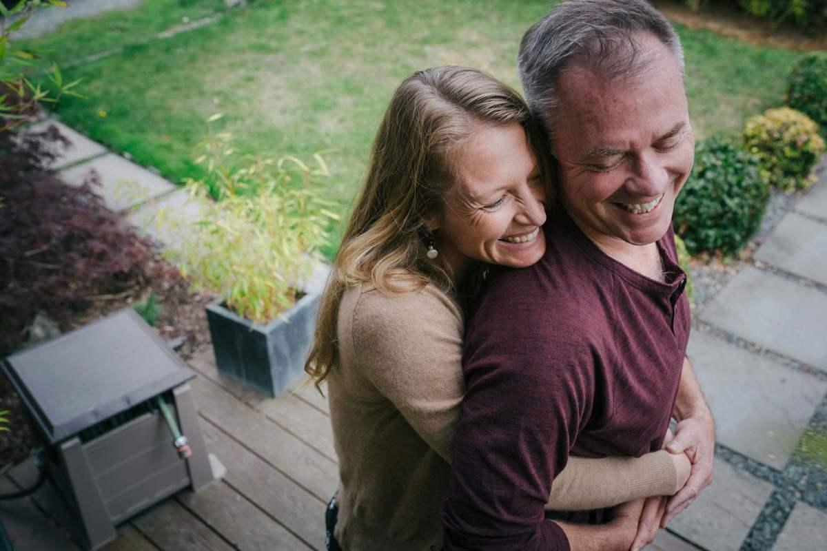 Smiling couple hug outdoors