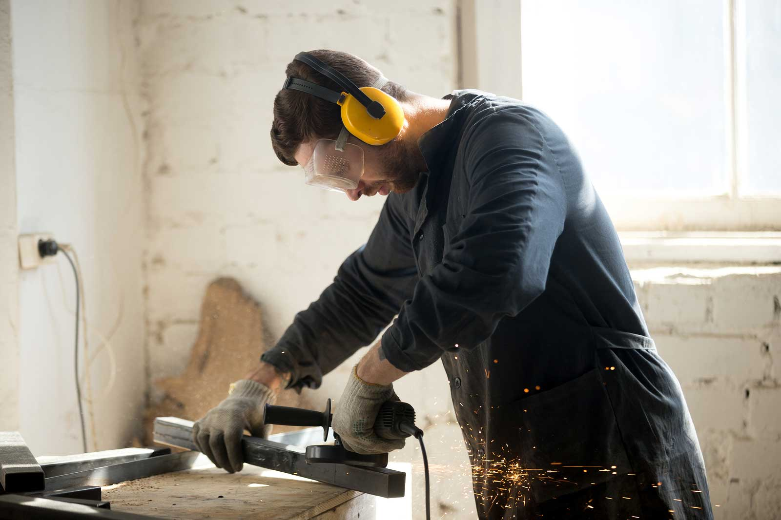 Man works on home improvement project with power tools.